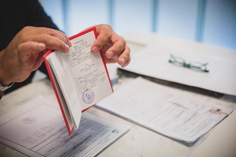 Firma y entrega de libreta